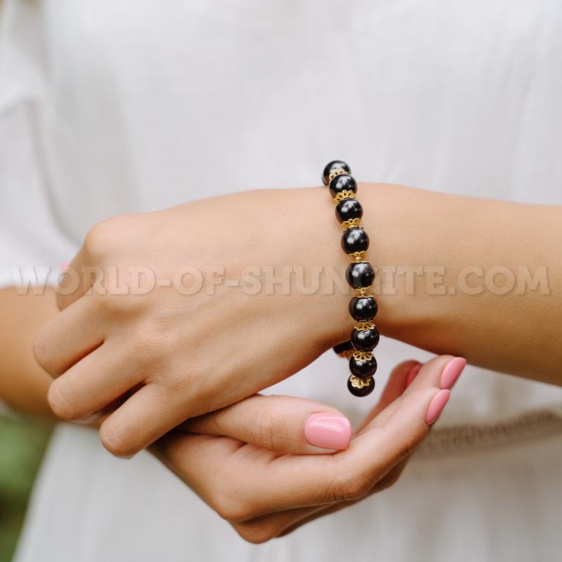Shungite bracelet with goldish roses and lock